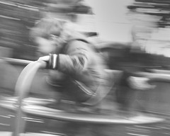 153 ~ roundabouts (- e l i -) Tags: blur playground fun happy child roundabout elirees