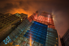 The Fortress of Glassitude (Explored) (Strykapose) Tags: nyc newyorkcity longexposure newyork rain night clouds nightshot newyorker explore slowshutter underconstruction longshutter ef2470mmf28lusm nycskyline orangeblue glasscurtainwall curtainwall cloudyday overcastskies explored glasspanes christiandeportzamparc nyccondo canon5d2 orangebluecontrast strykapose thetol
