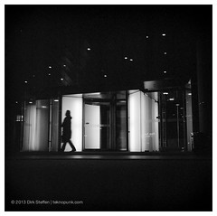silhouette (teknopunk.com) Tags: china 6x6 film silhouette night hotel blackwhite lowlight asia shanghai kodak entrance onewoman 18sec analoguephotography minoltamultipro trix4003200d76 rolleiflex8028e3sn2361561