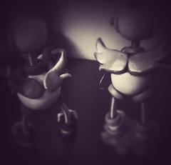 Sneak peek: they're making plans (HerArtSheLoves) Tags: white black wings with mixedmedia robots polymerclay scifi sciencefiction behindthescenes makingof sculptures teaser upcoming sneakpeak robotsculpture herartsheloves theawesomerobotscom