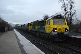 70003 in torrential rain passes through Bamford station with a Drax to Tunstead working, 9th Jan 2014.