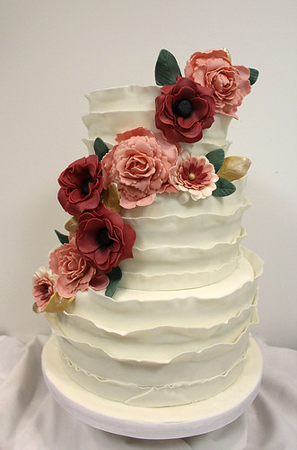 Wide Ruffles and Poppy Flowers Wedding Cake