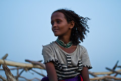 Afar girl in the village of Ahmed Ela. Danakil depression, Ethiopia (NeSlaB .) Tags: poverty africa travel sunset portrait woman colors girl beautiful beauty face look lady youth canon photo necklace eyes lowlight women village dress desert wind traditional country young culture photojournalism tribal clothes tradition ethiopia tribe ethnic society hairstyle developingcountries hairs reportage nationalgeographic ethnography ethnology afar etiopia danakil ethnies dancali dankalia ahmedela hafar neslab davidecomelli hafari