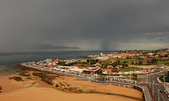 Storm coming in  - Gijon, Spain (Una S) Tags: city espaa storm streets beach rain clouds boats spain sand yacht gijon thunder