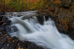 Passing Through Autumn (SunnyDazzled) Tags: waterfall fall foliage autumn leaves creek river stream pretty colorful landscape longexposure flowing evening newjersey wanaque forest