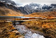 Cwm Idwal (johnroberts676) Tags: cwm lake llyn idwal grass snowdonia snow footbridge stream mountains wales water nikon