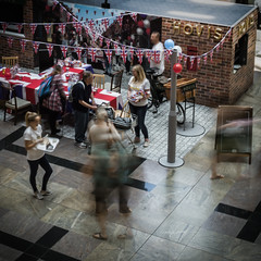 Moving with the times (Caroline Oades) Tags: 161366 09062016 qe2 queenelizabethii birthday celebrations 90 unionjack redwhiteandblue red white blue hovis baker breadmaker bread sandwiches teaparty bunting shoppingcentre southampton slowshutterspeed moving history