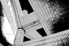 Hong Kong 24 (kruser1947 (all killer no filler)) Tags: bw blackwhite monochrome abstract architecture geometric hongkong leadinglines lookingup