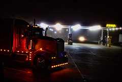 As She Purrs Me To Sleep (raymondclarkeimages) Tags: raymondclarkeimages rci 8one8studios usa outdoor trucking kenworth kw truck diesel sunoco fuel 6d canon night 50mm18stm lights bigtruck transportation cdl semi sleeper conventional tractor flickr google yahoo