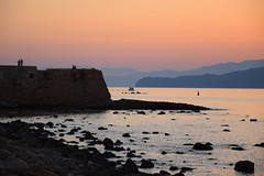 calm... (JoannaRB2009) Tags: sunset sea water calm peaceful island hill layers weather air fortezza old historical harbour chaniavenetianharbour landscape seascape mediterranean nature view people silhouettes evening colours sky rocks stones building wall chania hania xania canea crete kriti kreta greece summer