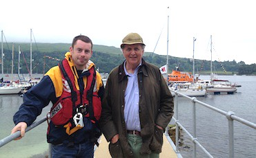 Andrew McHaffie Coxswain Tobermory LIfeboat with Alexander McCall Smith at Lochaline