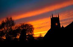 Tavistock, 4.40 pm (snowyturner) Tags: trees sunset sky orange tower clock church silhouette st night cloudy devon tavistock eustachius