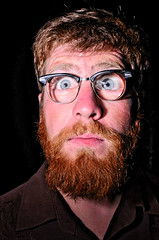 THIS IS PHIL (MetalMooseBoy) Tags: blue red portrait man silly sexy beard glasses funny awesome blueeyes redbeard magnified bearded beardedman sexyman vision:sunset=0575 vision:outdoor=0815