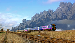 158754 passes the inferno (delticfan) Tags: fire smoke pollution northernrail class158 158754 hambletonwestjunction