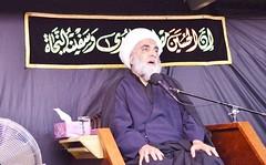 Sheikh delivering Muharram Lecture