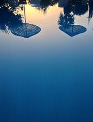 Sunset reflections on the pool (VillaRhapsody) Tags: blue sunset pool umbrella reflections dusk swimmingpool challengeyouwinner