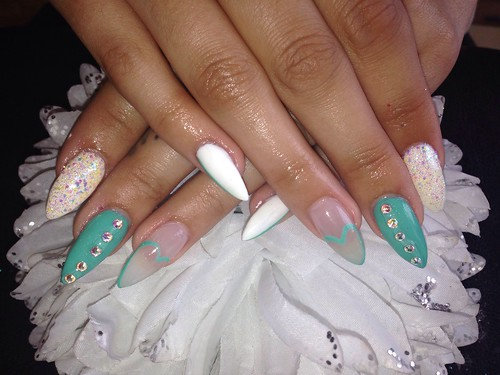 Acrylic nails with white gelish gel polish jades a gem gelux gel polish Swarovski crystals