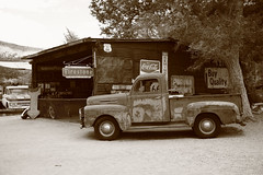 Route 66 Garage (Frank Footer Fotos) Tags: auto road trip travel vacation arizona sky usa white signs black southwest west art classic home station shop wall sepia rural america truck vintage photography freedom town office store highway desert general cola framed garage small country rustic fine shed mother machine rusty murals pickup az mobil roadtrip 66 historic retro gas adventure business route nostalgia lorry repair posters buy prints americana service kicks motor firestone roadside decor coca rt filling attractions hackberry