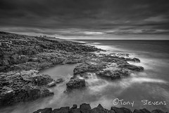 Dunstanburgh from Craster (snotty7) Tags: longexposure sea sky blackandwhite seascape monochrome clouds rocks waves dunstanburgh dunstanburghcastle