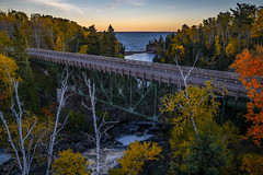 Tettegouche Bridge (Paul Domsten) Tags: tettegouchestatepark minnesota northshore lakesuperior baptismriver pentax river trees fall autumn colors lake water yellow orange bridge highway61 nature beauty scenery dusk foliage serene tree outdoor landscape