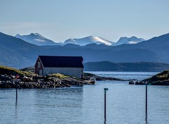 Waterfront Scenery (bjorbrei) Tags: water sea fjord hills mountains coast seaside waterfront bud romsdal norway seahouse