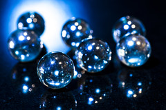 Blue marbles (carrieduay) Tags: blue light black reflection shiny bokeh reflective glassmarbles
