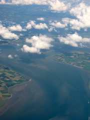 Water (K.G.Hawes) Tags: sea cloud white water netherlands clouds airplane landscape coast view cloudy farm air creative plan commons aeroplane aerial cc creativecommons farms