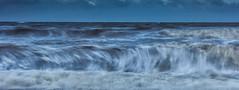 Wave power (crossland_alan) Tags: uk morning seascape canon landscape coast movement energy brighton waves power hitech 400d 6stop 1585mm