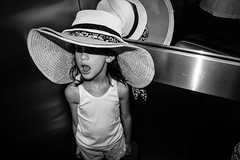 3 hat is très chic! (Claudio Beck) Tags: blackandwhite bw sun beach girl hat brasil mirror beck interior sony elevator paulo openmouth claudio são spontaneous whiteshirt bighat ilce3000