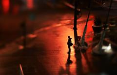 Standing Alone (DIY tilt-shift lens test) (Brandon Proulx) Tags: life city red color night dark lens 50mm lights weird miniature diy cool nikon focus shadows awesome shift denver homemade blacks neat tilt tiltshift