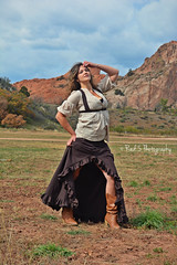 Wild West (Red 5 Photography) Tags: ranch brown mountains west field grass fashion colorado gardenofthegods skirt cowgirl wildwest cowboyboots steampunk oldwest dramaticpose hairblowinginwind red5photography foggcouture vision:outdoor=0983 vision:sky=0546 leaugeoffogg