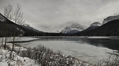 Frozen (CNorthExplores) Tags: park travel autumn lake snow canada mountains canon rockies frozen cloudy canadian national alberta banff g11 waterfowllake explored