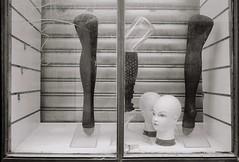 Head over Heels (ahatingape) Tags: white black paris france film mannequins legs heads fujiklassew