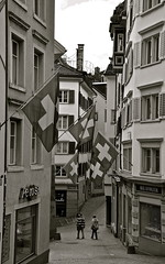 Zurich - Switzerland (Sandrine Vivs-Rotger photography) Tags: street switzerland zurich flags tourists