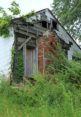 North Elevation, House with Log Addition — New Vienna, Ohio (Pythaglio) Tags: vienna county new ohio chimney house brick abandoned window overgrown pen log exterior clinton board historic rake single vacant siding residence strips gable dwelling asbestos hewn notching furring hewed halfdovetail