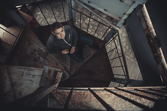 Stairs (Vadim.Cojuhov) Tags: man portrait nature lost canon 6d 28mm done well one alone fire mountains textures aperture face eyes look see friend forward only like incredible found shadows hightlights moment tattoo boy scene nude moldova torch flambeau cresset camera film composition portfolio stock spirit soul vista fate fortune cup chance work north people bad caricature reservoir dogs criminal minds pulp fiction biker strong mustasche beard black background indoor electronics treasure light flash hair long stairs mystic dark