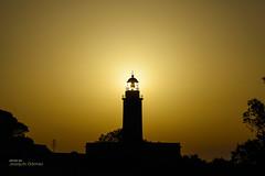 Sun's tower (Oddiseis) Tags: formentera balearicislands spain lamola light lighthouse sun sunrise sunglare silhouette tamron247028 yellow contrast tower