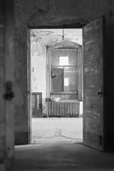 Ellis Island Isolation Ward (LeavenworthObey) Tags: ellisisland nationalmonument selectivefocus framewithinaframe composition light history isolationward southside southisland nationalparkservice leicam9 digitalzonesystem bw digitalphotography 2016 windowdetail documentation heritagedocumentationprograms