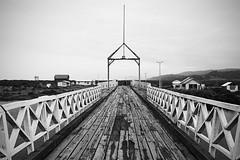 a way to... (Pirkipetola) Tags: ponte bridge isladechilo chilo patagonia viaggionelmondo viaggio viaggiare travel travellers flickrtravelaward america americasur americalatina sudamerica sudamericana southamerica bn bw blackwhite blackandwhite blackdiamond perspective prospettiva orizzonte zainoinspalla backpackers