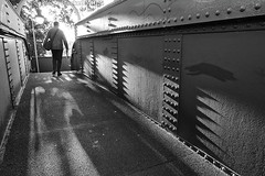 11th MoNovember 16 (cazphoto.co.uk) Tags: monovember monovember16 monochrome blackandwhite nov15 111116 panasonic lumix dmcgh3 panasonic1235mmf28lumixgxvarioasphpowerois bridge railway station ingatestone shadows commuter rivets sunny