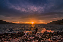Solitude (Vagelis Pikoulas) Tags: solitude lonely man waves wave wavy sea seascape landscape rock rocks canon 6d tokina 1628mm porto germeno greece europe sun sky sunset sunburst sunshine clouds cloud cloudy afternoon 2016 autumn november