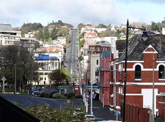 Dunedin. Looking up High Street in the city street from  Queens Gardens. JPG (denisbin) Tags: dunedin wainshotel statues greekgods artdeco hihgstreet hilly highstreet queensgardens