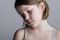 Sad Looking Child against a Grey Background (mommymundoxyz) Tags: abuse adorable alone beautiful blond blonde child childhood cute dark depressed depression dramatic emotional expressing expressive face female girl grief innocence innocent kid life little loneliness lonely pain portrait pouting sad sadness copyspace suffering upset vest white young caucasian greybackground