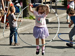 Jumping Through the Hoop (dons projects) Tags: city people sun playing canada sports sunshine june festival kids vancouver children jumping play bc zoom candid hulahoops sunny streetscene olympus canadian celebration hoops eastside sonnig sonne commercialdrive zuiko vancouverbc eastvan eastvancouver cityscene evolt thedrive e500 zd fourthirds 1445mm 2013 italianday photoscape seeninvancouver kodakccd donsprojects
