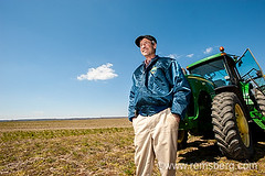 Farmer standing with tractor in the field (Remsberg Photos) Tags: people usa man male adult farm country grain maryland pride identity intelligence american passion worker farmer stleonard satisfaction agriculture laborer determination skill individuality expertise realpeople harvestor tractordriver