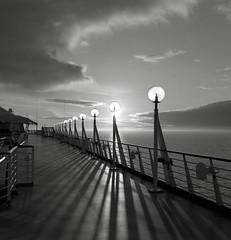 Lamps, Inside Passage, Alaska (austin granger) Tags: light sunset film alaska square shadows patterns deck cruiseship lamps railing insidepassage globes gf670 austingranger