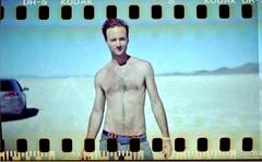 Spencer on the Playa (Darin Barry) Tags: dessert burningman theplaya hunkymen blackrockdessert manin30s holgagfn120 sprocketshots sprocketholeshot guyindessert underwearlabels