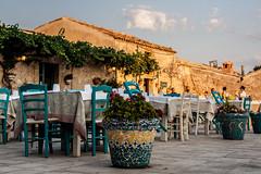Quasi ora di cena. (stars`bread) Tags: sunset sun restaurant vacances soleil holidays tramonto chairs tables sole sedie ristorante marzamemi sicilia chaises vacanze tavoli coucherdusoleil canoneos1000d