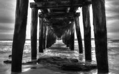 Under the Jetty (Tiers of Brad) Tags: ocean water coast pier waves timber jetty pylon pylons