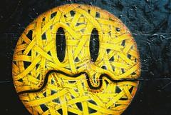 Brick Lane Market (Cris Ward) Tags: street uk summer people streetart color colour london film public face yellow wall thames 35mm shopping painting graffiti iso100 lomo lomography saturated artwork stencil mural colorful paint bright market kodak britain candid tag vivid sunny olympus xa2 east negative smiley pointandshoot products spraypaint produce colourful olympusxa2 bricklane selling stalls aldgate compact cityoflondon emote ektar c41 finegrain lomographyuk
